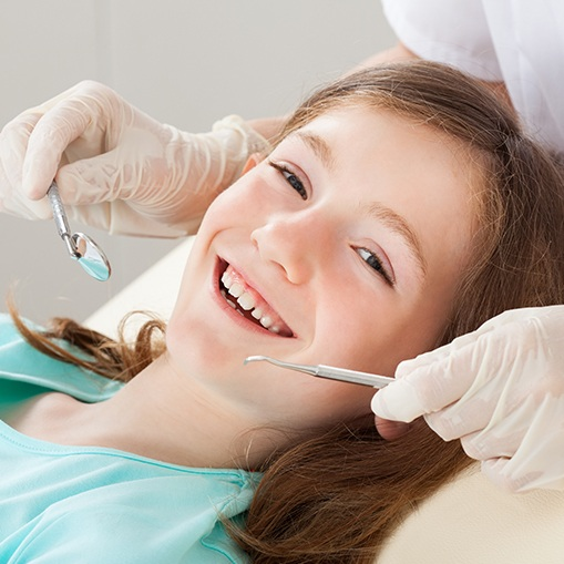Young girl receiving dental checkup and teeth cleaning