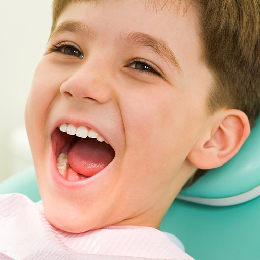 Little boy laughing after receiving tooth colored filling