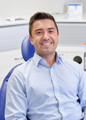 Man with healthy smile during preventive dentistry visit
