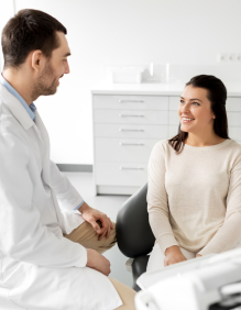 Dentist discussing cosmetic dentistry options with dental patient