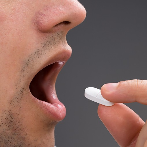 Patient taking oral conscious sedation dentistry pill