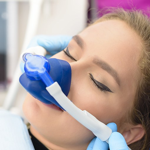 Woman with nitrous oxide sedation dentistry mask in place