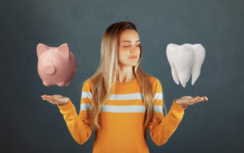 Woman choosing between piggy bank and dental care