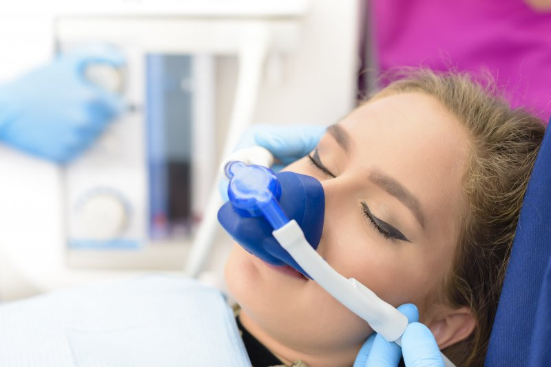 a woman undergoing nitrous oxide sedation during an appointment